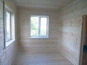 Каркасный дачный дом с отделкой деревянной вагонкой и блок-хаусом в Пензе